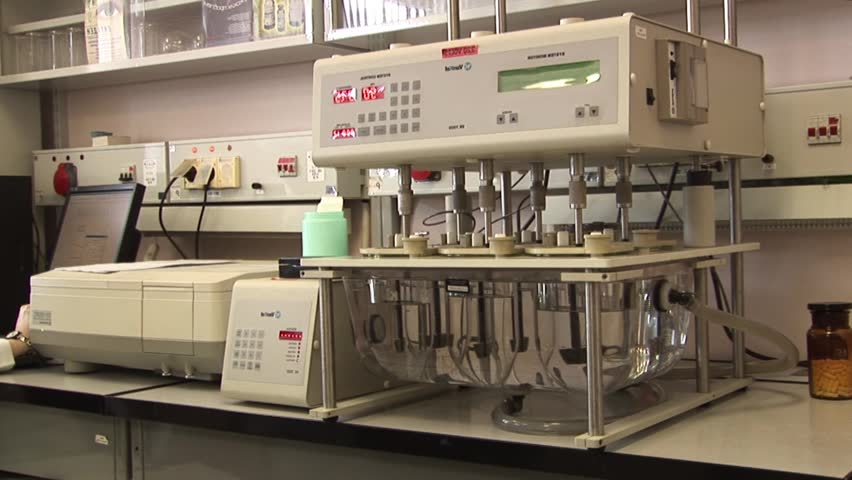 Mixing solution in a laboratory - HD stock footage clip