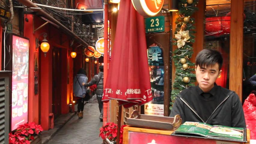 SHANGHAI - DECEMBER 21: Restaurant receptionist in Shanghai Tianzifang.