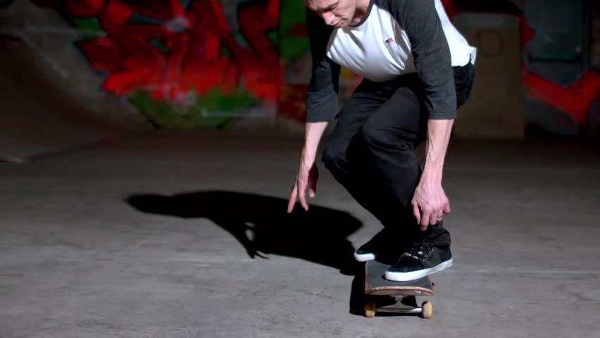 Front view of skater doing 360 flip in slow motion - HD stock footage clip