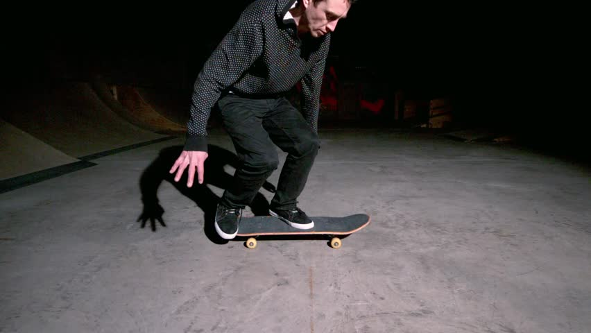 Skater doing 360 flip trick in slow motion - HD stock footage clip
