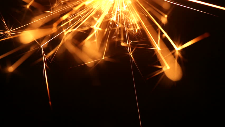 Firework sparkler burning in macro shot
