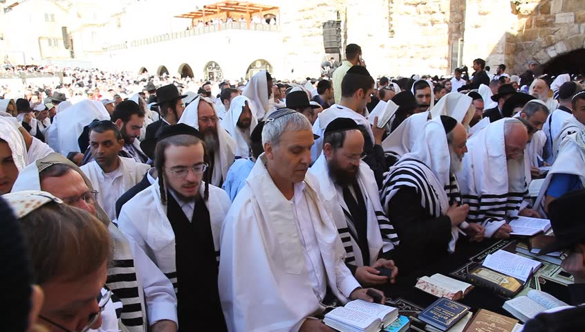 JERUSALEM, ISRAEL -  MARCH 28: Thousands of Jews practice the Priestly Blessing  (Hebrew - Birkat Cohanim) at the Western Wall plaza during the Passover Holiday, March 28 2013 in Jerusalem, Israel.