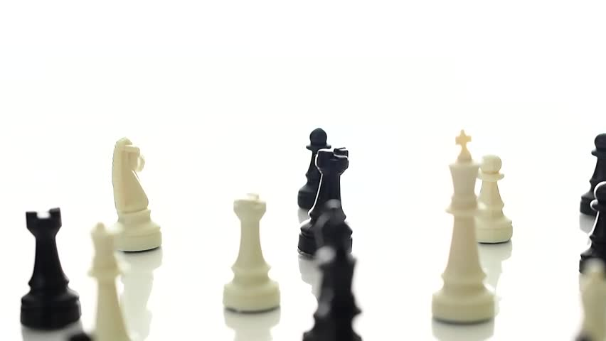 Chess pieces rotating on a white studio background.