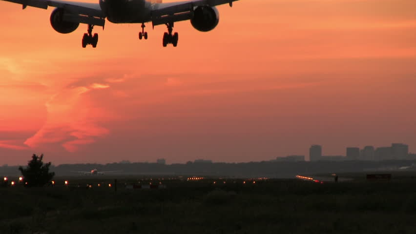 Big plane landing at dusk
