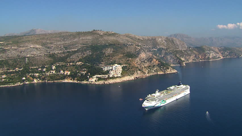 A big cruise ship in the waters of Dubrovnik, Adriatic sea. Aerial helicopter