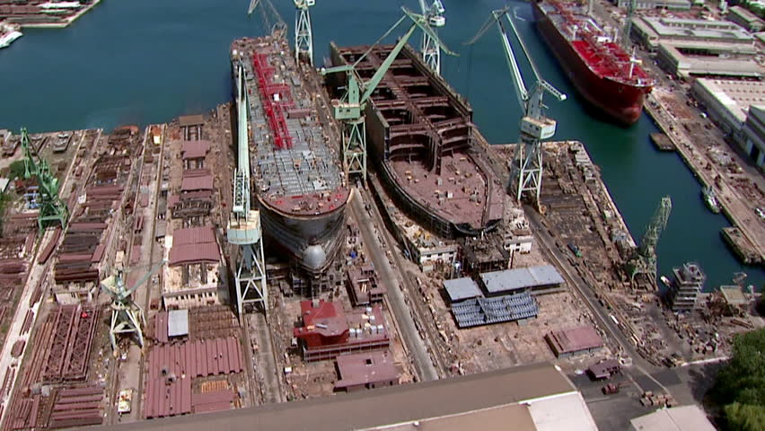 Ships in a shipyard. Aerial helicopter shot.