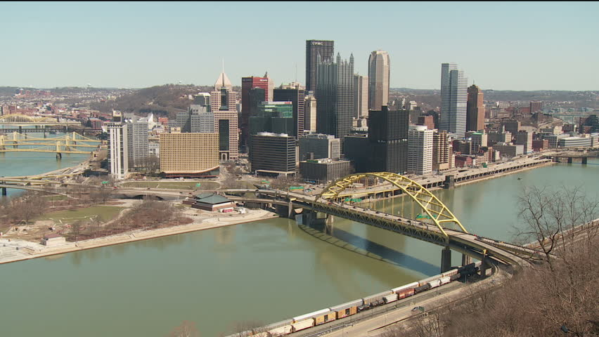 The downtown area including the skyline, bridges, and Point State Park at the confluence of the Allegheny and Monongahela Rivers in Pittsburgh, Pennsylvania. - HD stock video clip