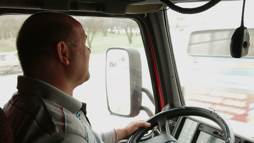 Lorry driver at the wheel of truck - HD stock video clip