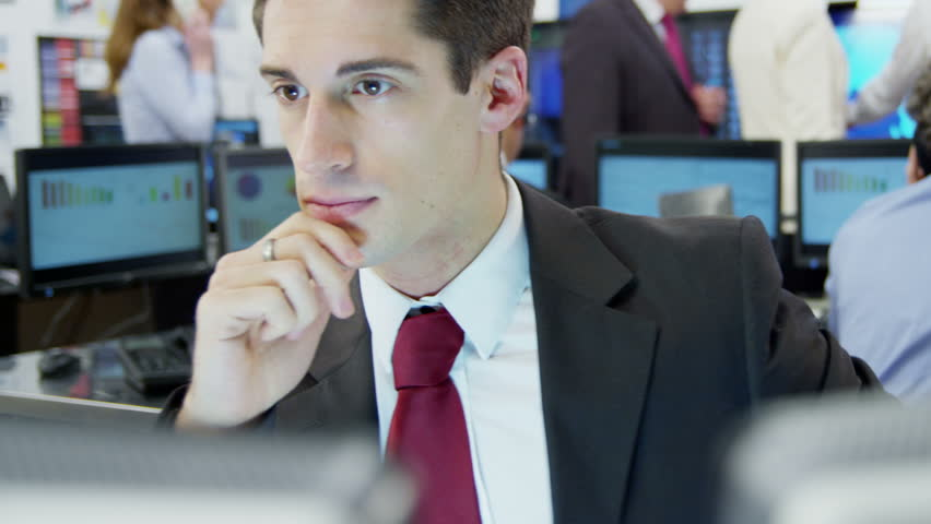 Young and ambitious financial trader has cause for concern when the stock market crashes - HD stock footage clip