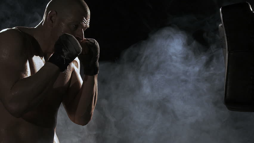 Kickboxer shadow boxing as exercise for the big fight, shot on Red Epic - HD stock footage clip