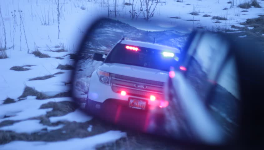 Pulled over by the police in the rear view mirror. - HD stock video clip