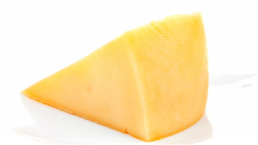 french gourmet triangle of parmesan yellow cheese on a plate isolated over white background - HD stock footage clip