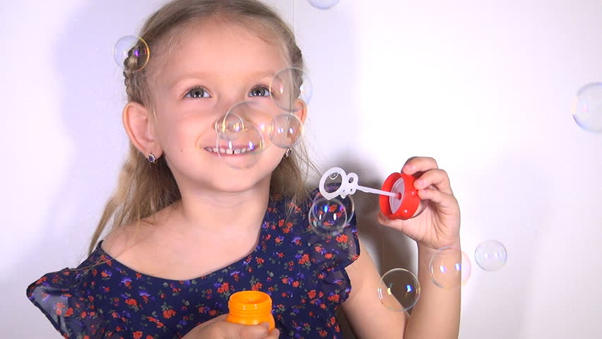 Child Blowing Soap Bubbles, Little Girl Playing making Balloons, Children  - HD stock video clip