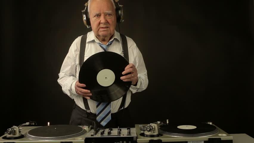 A very funky elderly grandpa dj mixing records  | Shutterstock HD Video #3730715
