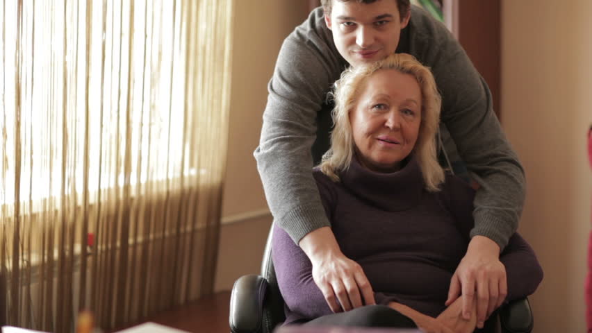 Thirty-year-old son hugs his mother looking to the camera. #3733433
