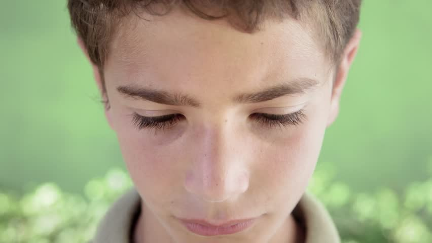 Young people and feelings, portrait of sad young hispanic boy looking at camera - HD stock video clip