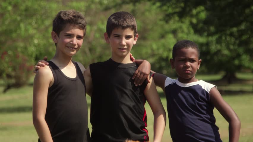 Young friends and recreation, three happy children with baseball smiling at camera - HD stock video clip