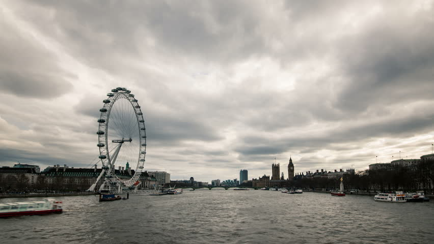 London skyline with London Eye and Westminster on Thames river in a cloudy day. - HD stock video clip