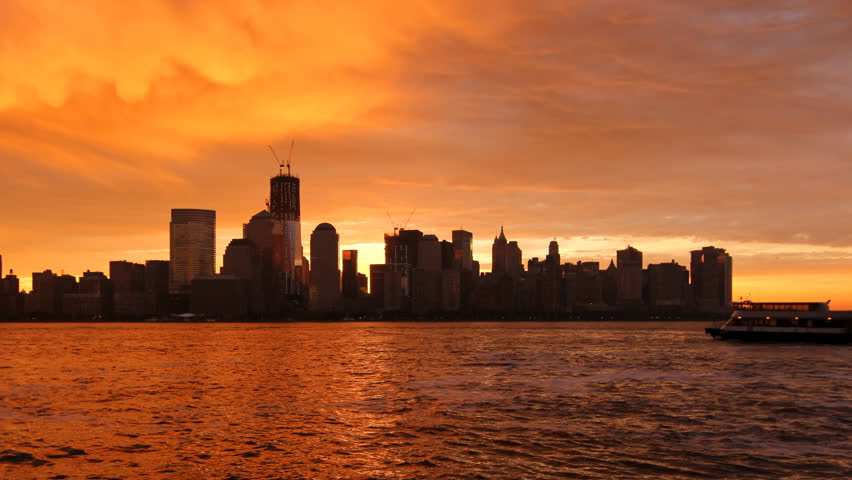 Sunrise over Lower Manhattan - Beautiful time lapse from night to day, with the sun appearing between the skyscrapers | Shutterstock HD Video #3778793