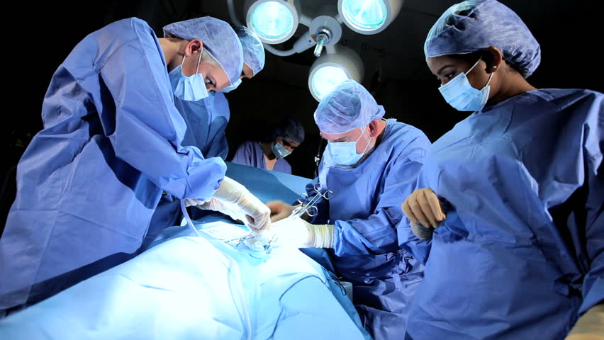 Senior doctor performing operation using surgical equipment helped by surgical team | Shutterstock HD Video #3782402
