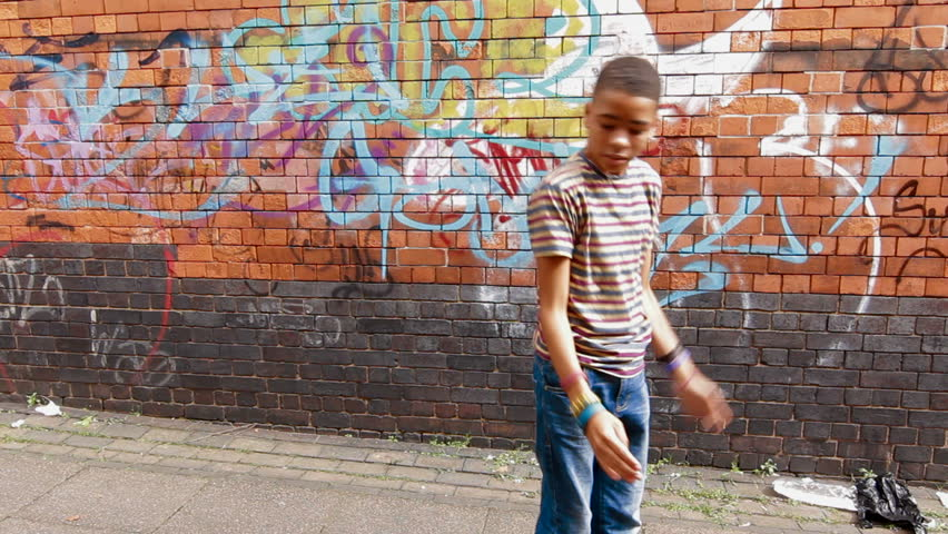 Street Dance - Mixed race boy street dancing in urban setting | Shutterstock HD Video #3787631