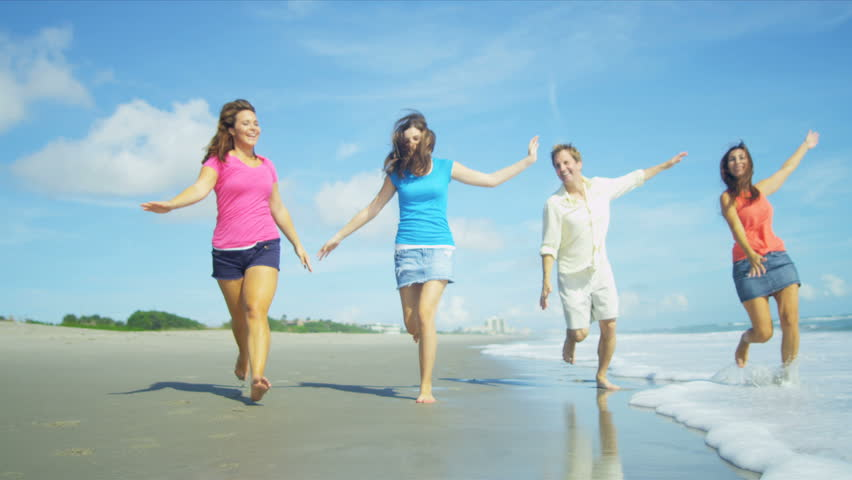 Carefree Caucasian parents teenage daughters playing laughing enjoying healthy beach lifestyle shot on RED EPIC | Shutterstock HD Video #3790034