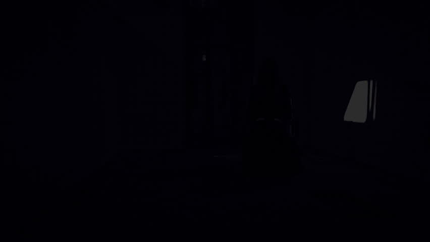 Horror Scene of a scary woman. Apparition of female ghost in black robe.