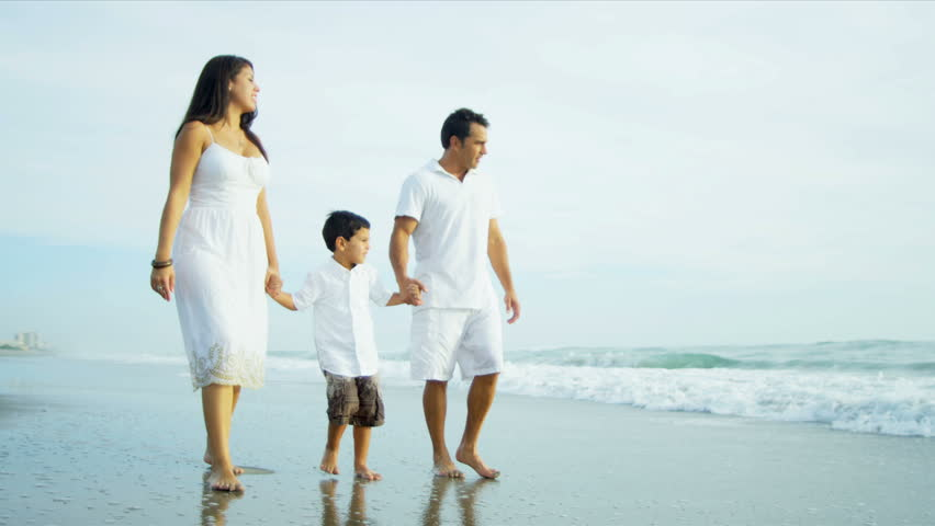 Hispanic young loving family spending vacation on beach shot on RED EPIC - HD stock footage clip