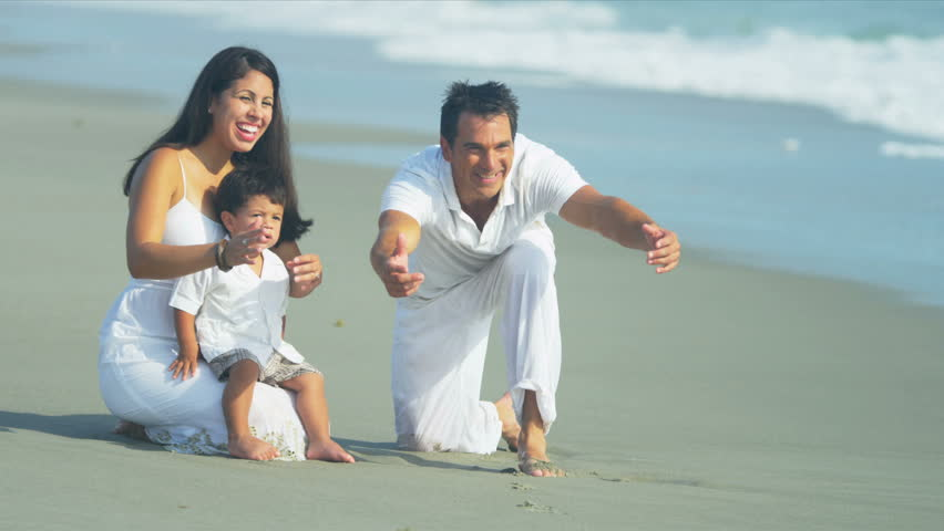Happy Latin American family spending summer holiday on beach shot on RED EPIC   Shutterstock HD Video #3819734