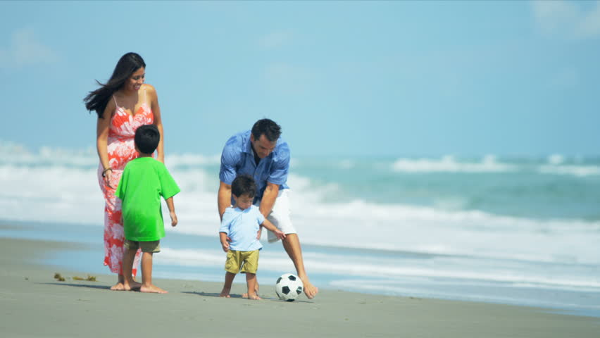 Hispanic young loving family spending vacation on beach playing soccer shot on RED EPIC - HD stock video clip