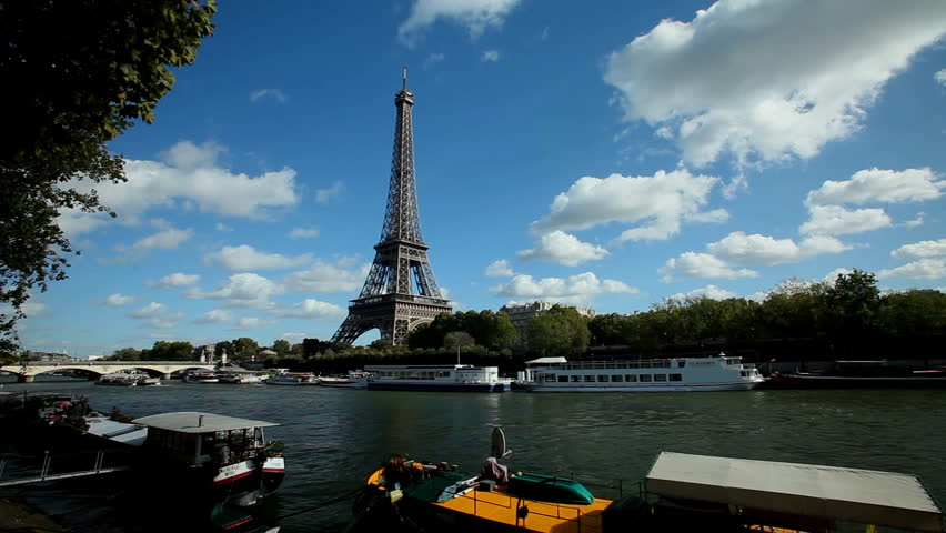 PARIS - OCTOBER 2012: View of boats on seine river and eiffel tower on October 12, 2012 in Paris, France. The Eiffel Tower is the most visited tourist attraction in Paris. | Shutterstock HD Video #3826592