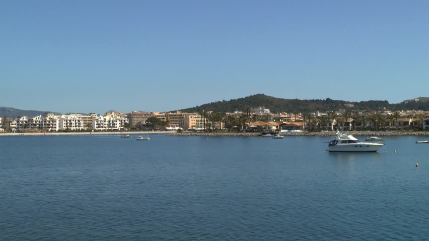 Tracking shot on the water along the beach of Alcudia located on the isle Mallorca in Spain.    - HD stock footage clip