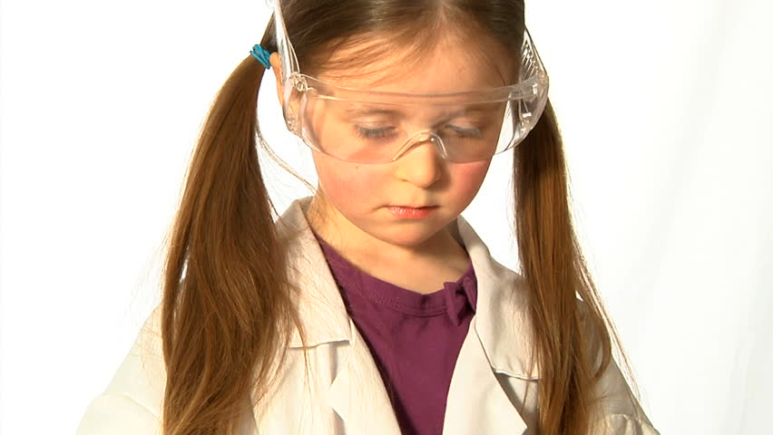 Young Scientist - A little girl, wearing adult safety glasses and lab coat, decants green liquid from a conical flask. - HD stock video clip
