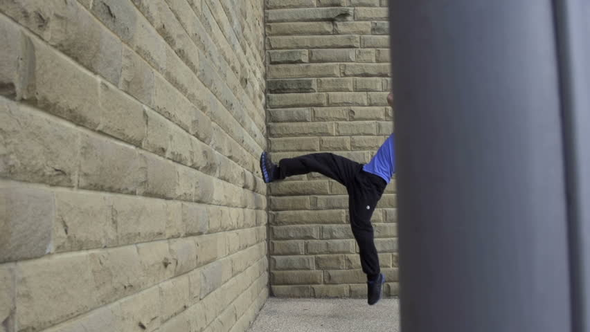 Backflip - Dolly: A free runner back flips off a wall in super slow motion