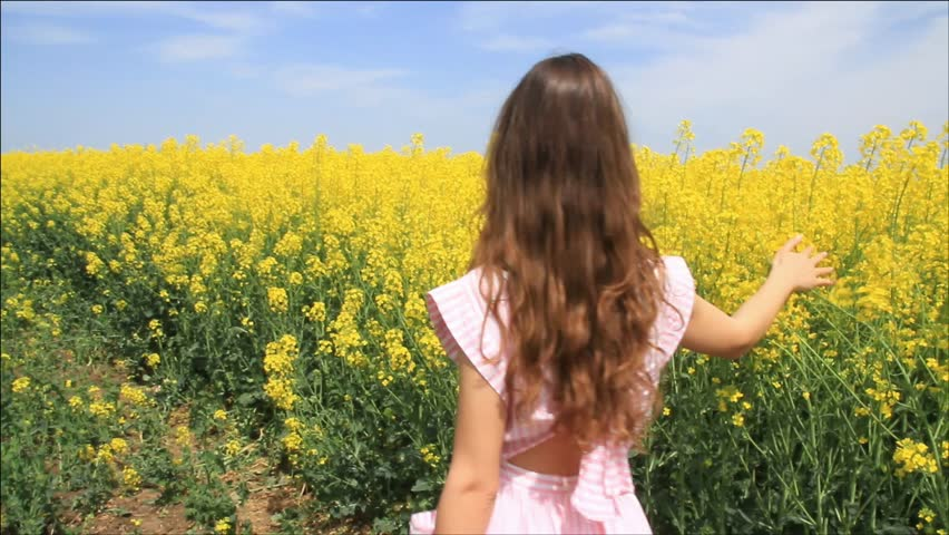 Young Woman In Vintage Dress Running Through Yellow Field ...