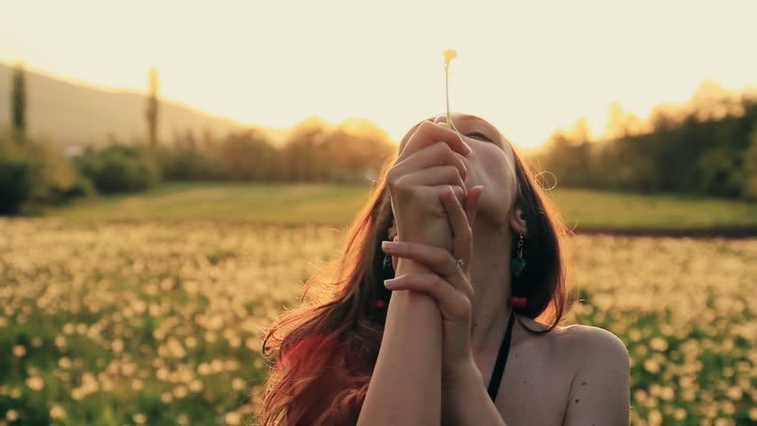 Beautiful Young Woaman Blowing Dandelion Laughing on a Summer Field HD