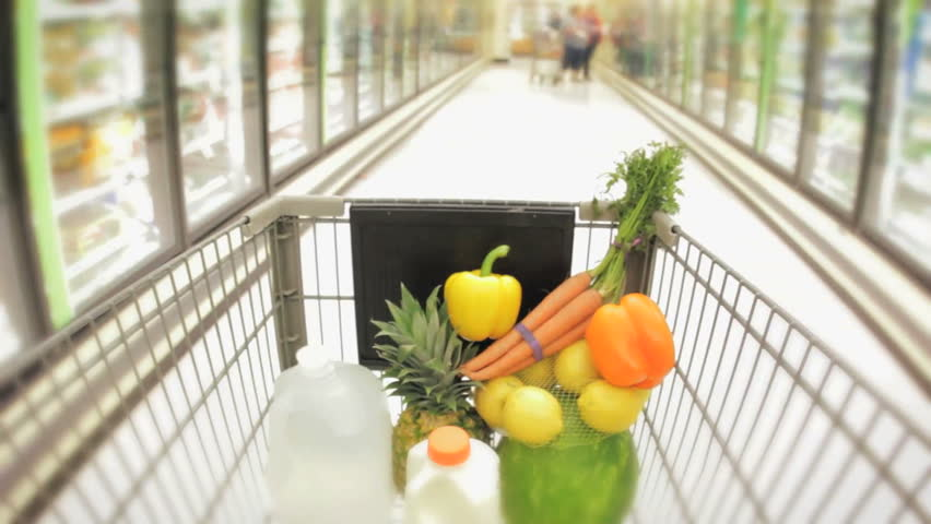 Shopping cart moving through supermarket aisles hidef hd healthy food in the basket  - HD stock video clip