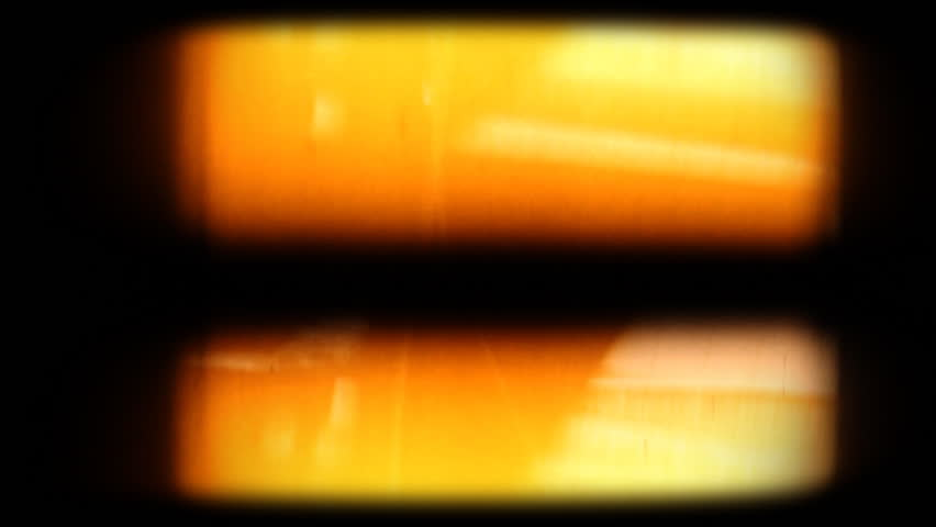 Blank 8mm film projected on screen with flicker. Composite this over your footage to get an old film look. Please see my large collection of film textures and effects for more clips like this.
