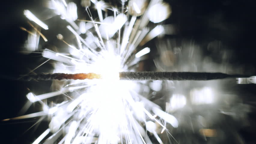 Close-up shot of flickering Christmas sparkler. Perfect for any kind of holidays or celebrations events. Seamless loop.