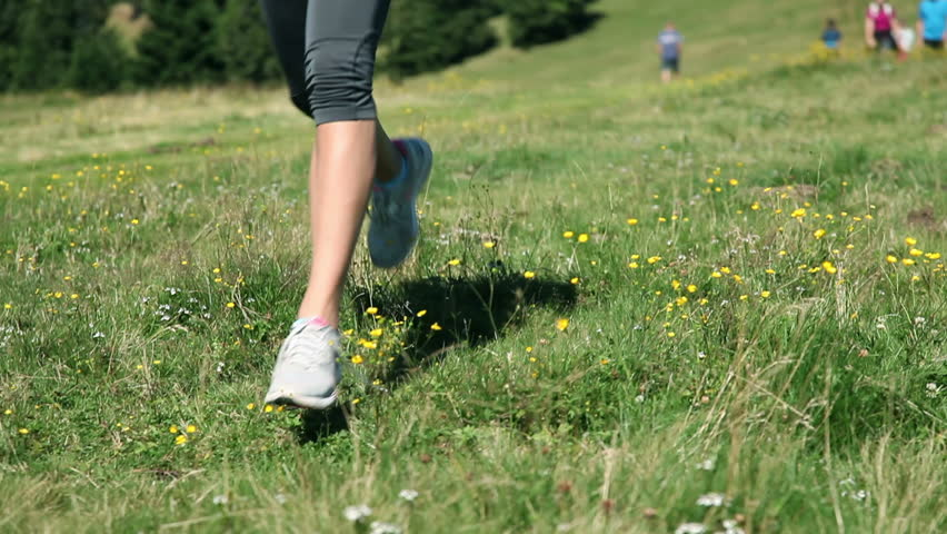 Woman tying up her shoelaces while running | Shutterstock HD Video #3874454