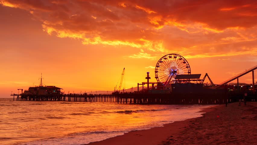 Sunset at Santa Monica beach pier, California. Zoom in on ferris wheel. HD Timelapse.