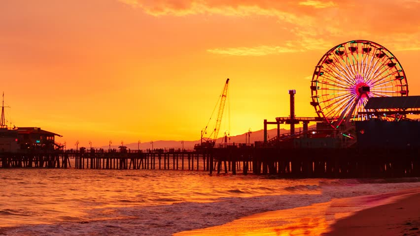 Pan across Santa Monica pier at sunset. Los Angeles, California. - HD stock footage clip