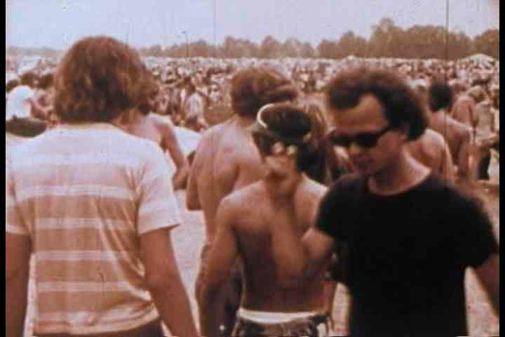 1970s - Hippies smoke dope and pot and do drugs at a rock concert in the 1970s.
