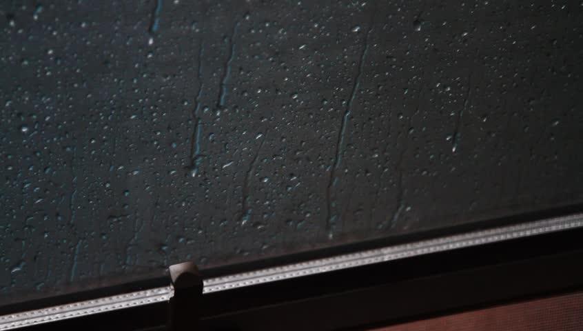 Heavy rain on open window glass  - HD stock video clip