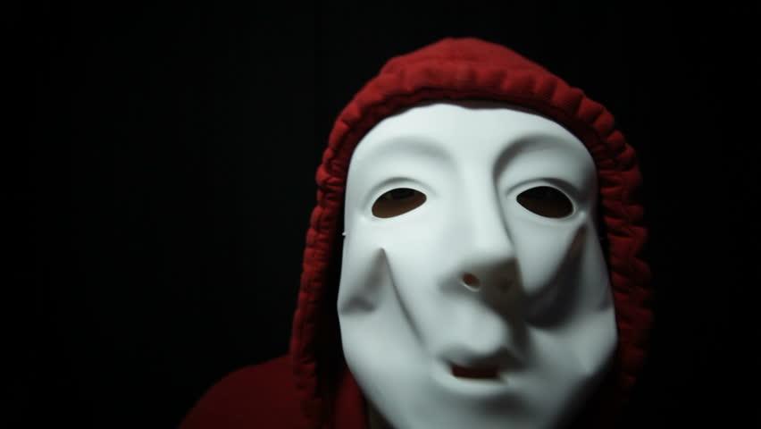 Mad horror masked man in darkness