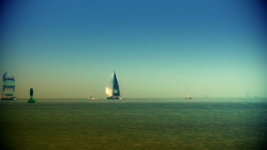 Boats sailing at sunset, zoom out | Shutterstock HD Video #3953357