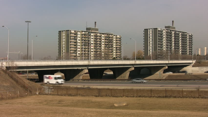 TORONTO - APRIL 3. Bridge crossing highway 401, Toronto, Canada, April 3rd, 2009. Highway 401 in Toronto is one of the widest and busiest highways. - HD stock video clip