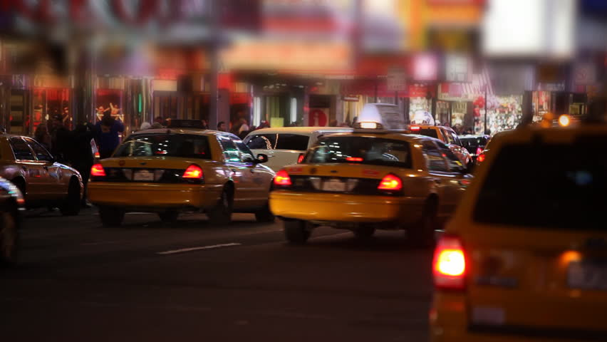 Taxis passing by on Times Square Manhattan, New York City / HD1080 / 29.97fps - HD stock video clip