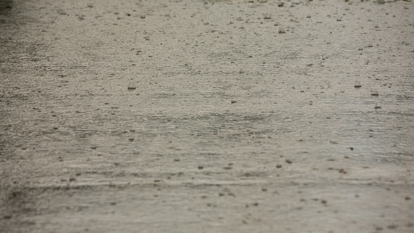 Massive downpour of rain falling from the sky. Some small hail stones falling present. Disaster. - HD stock footage clip