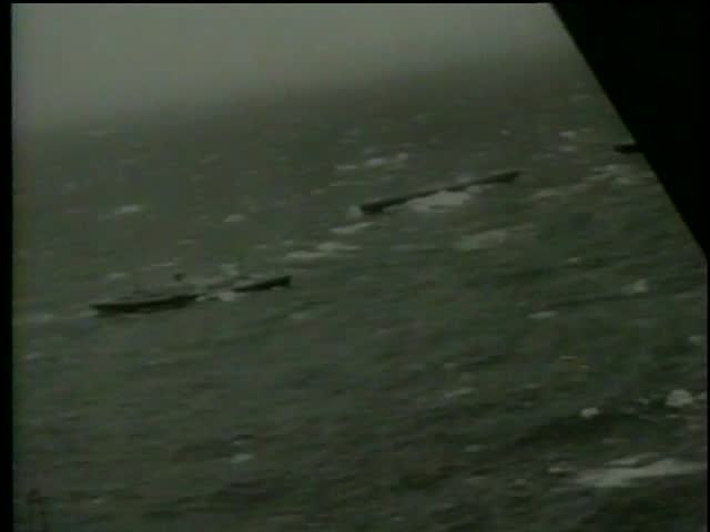 View from the airplane of sinking british ship Ambassador and international rescue ships in Halifax, Nova Scotia, Canada circa 1964-MGM PICTURES, UNIVERSAL-INTERNATIONAL NEWSREEL, USA, filmed in 1964 - SD stock footage clip